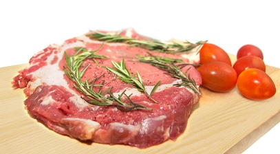 Fresh raw beef with herbs and tomatoes